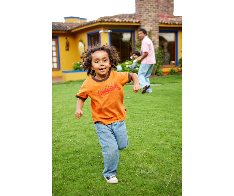 child running in the backyard
