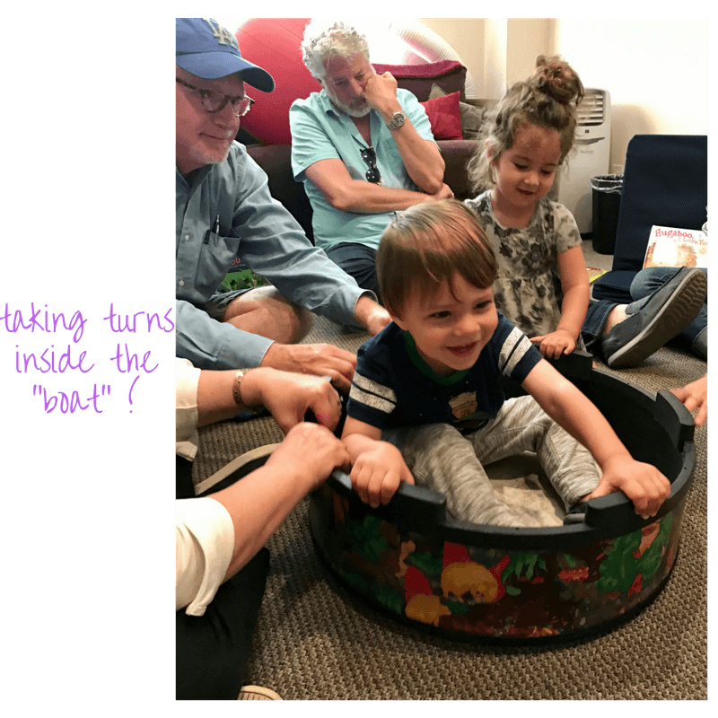 toddlers playing inside a pretend boat at early childhood development class
