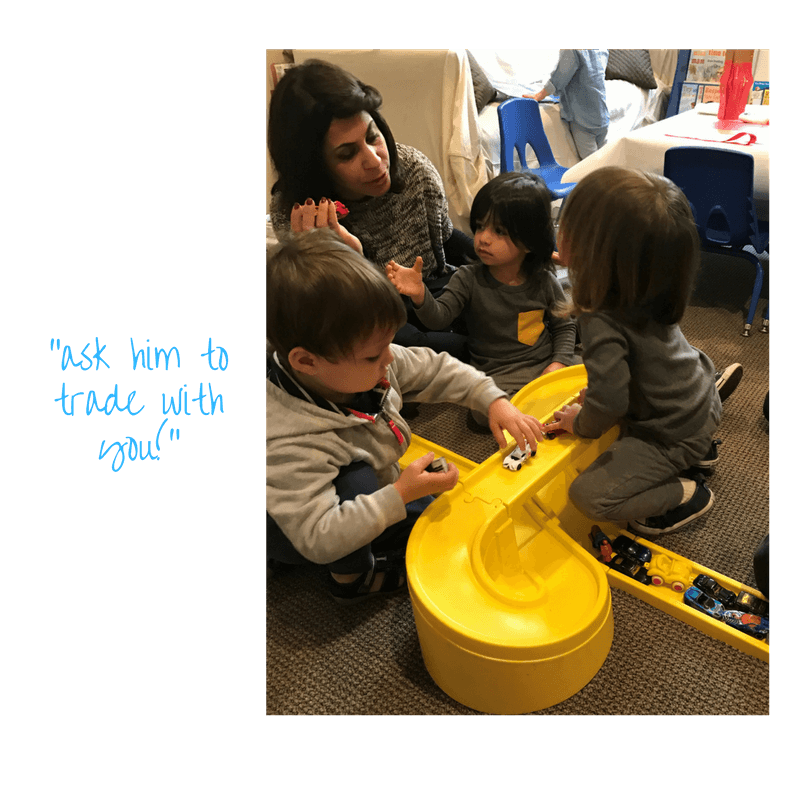 adult teaching toddlers how to play together with cars trading and taking turns at early childhood development class