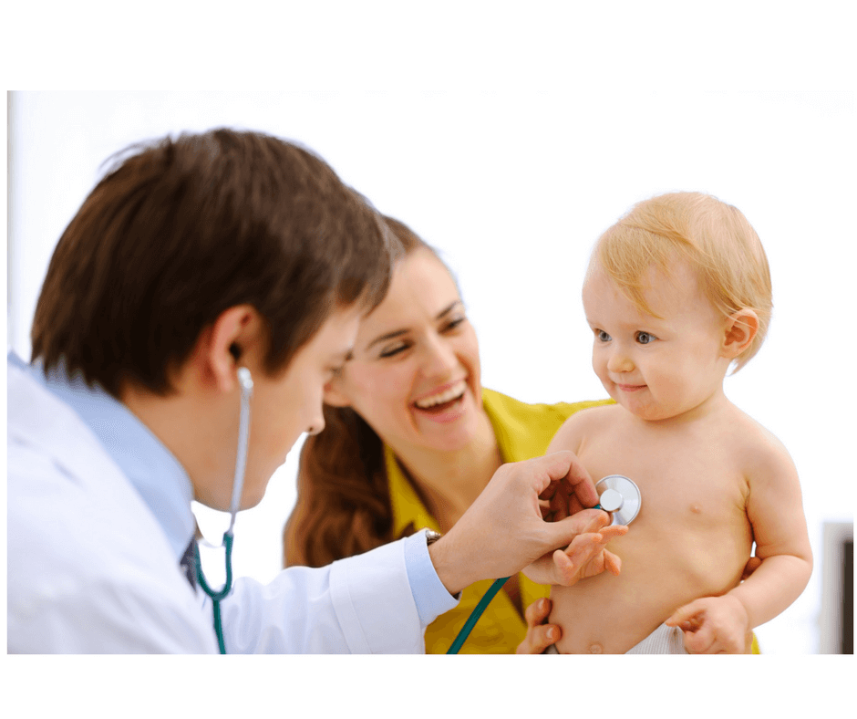mother doctor and toddler at doctor's office, doctor checking toddler's heart beat