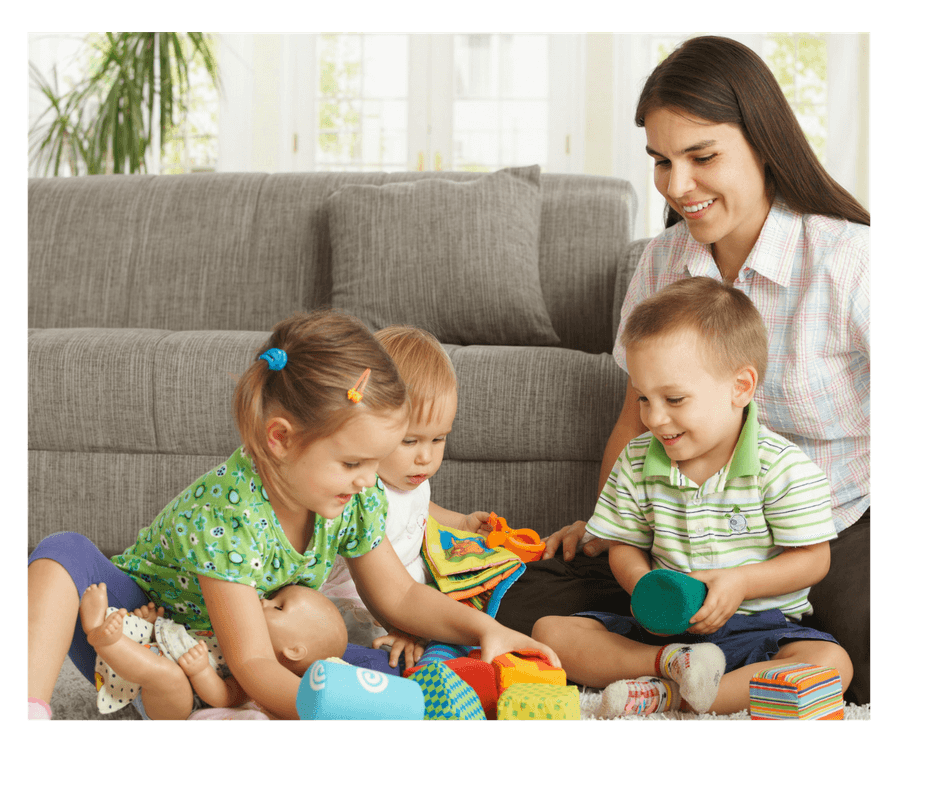 mom helping children to share during playdate