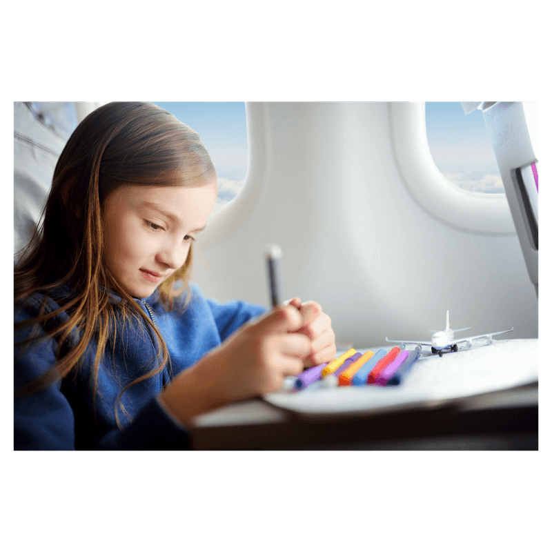 girls sittting on airplane playing and drawing