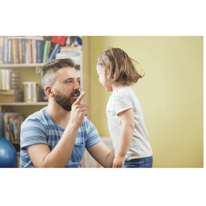 father disciplining toddler daughter