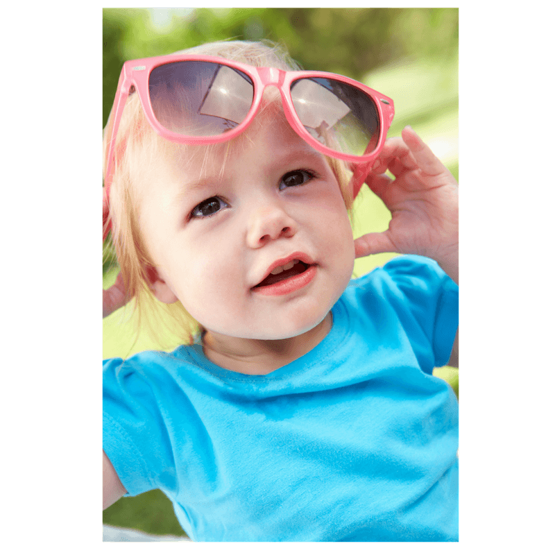 little girl playing with sunglasses imitating mom