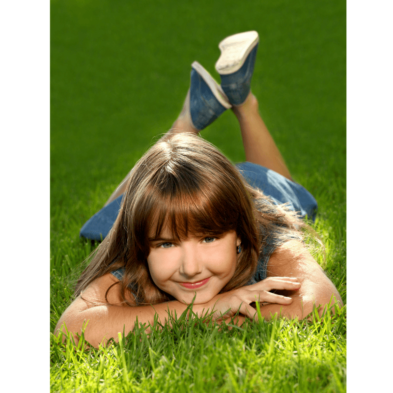girl lying on the grass at the park