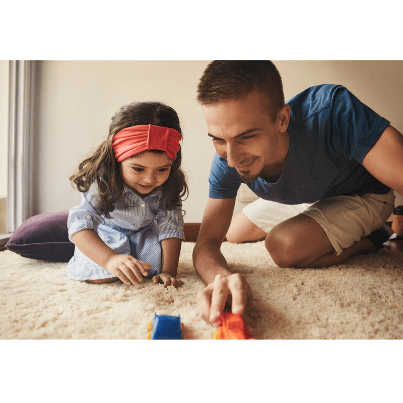 dad and toddler daughter playing cars and talking