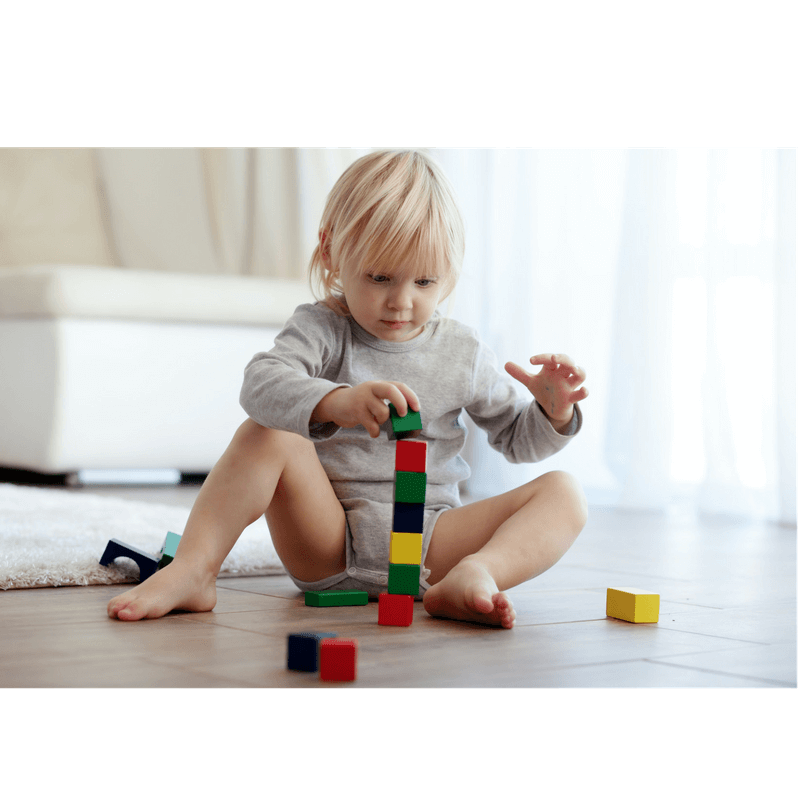 toddler stacking woden blocks