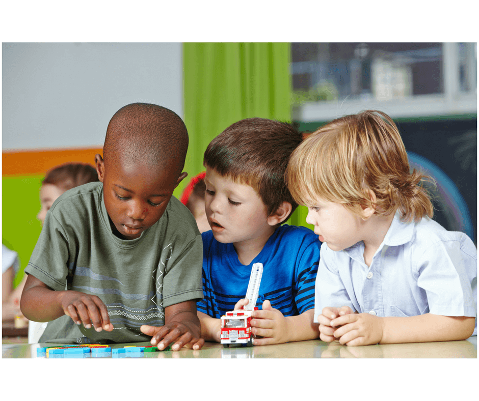 3 toddlers playing together developing social skills at early childhood development class