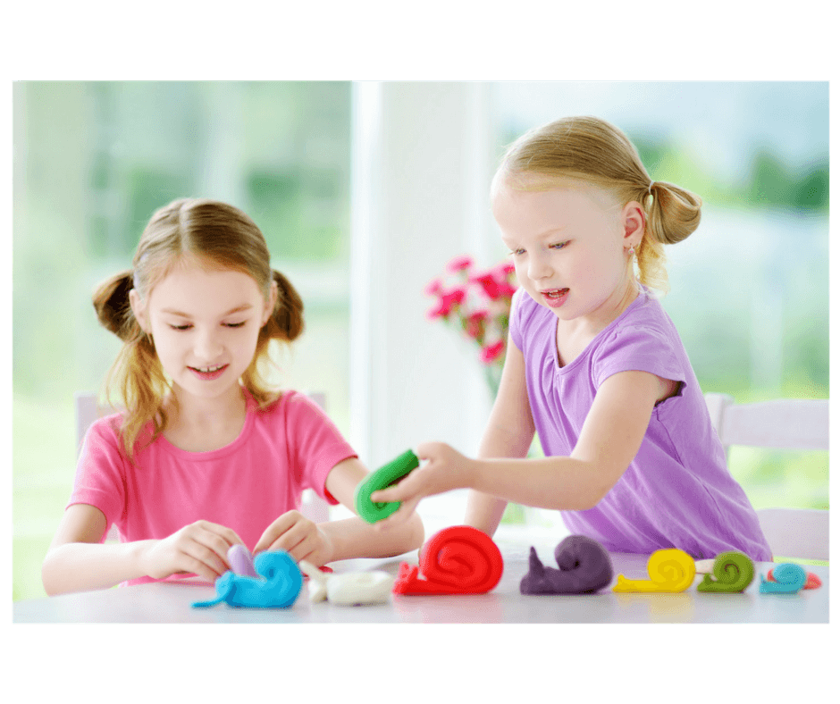 2 girls playing together with playdoh
