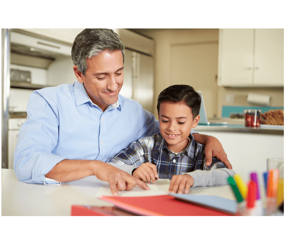 father and child making book together