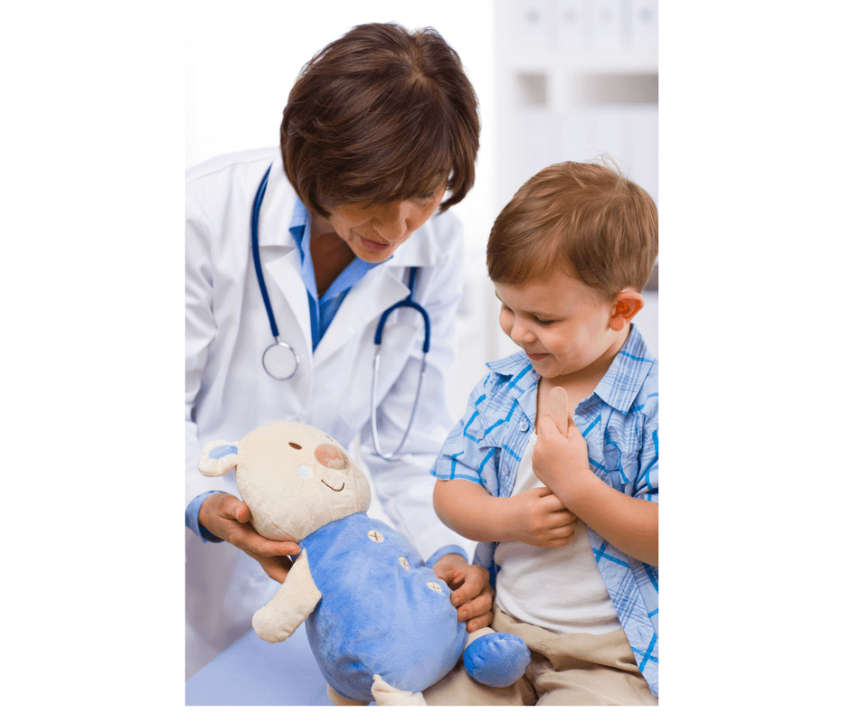 doctor and child playing in the office with stuffed animal