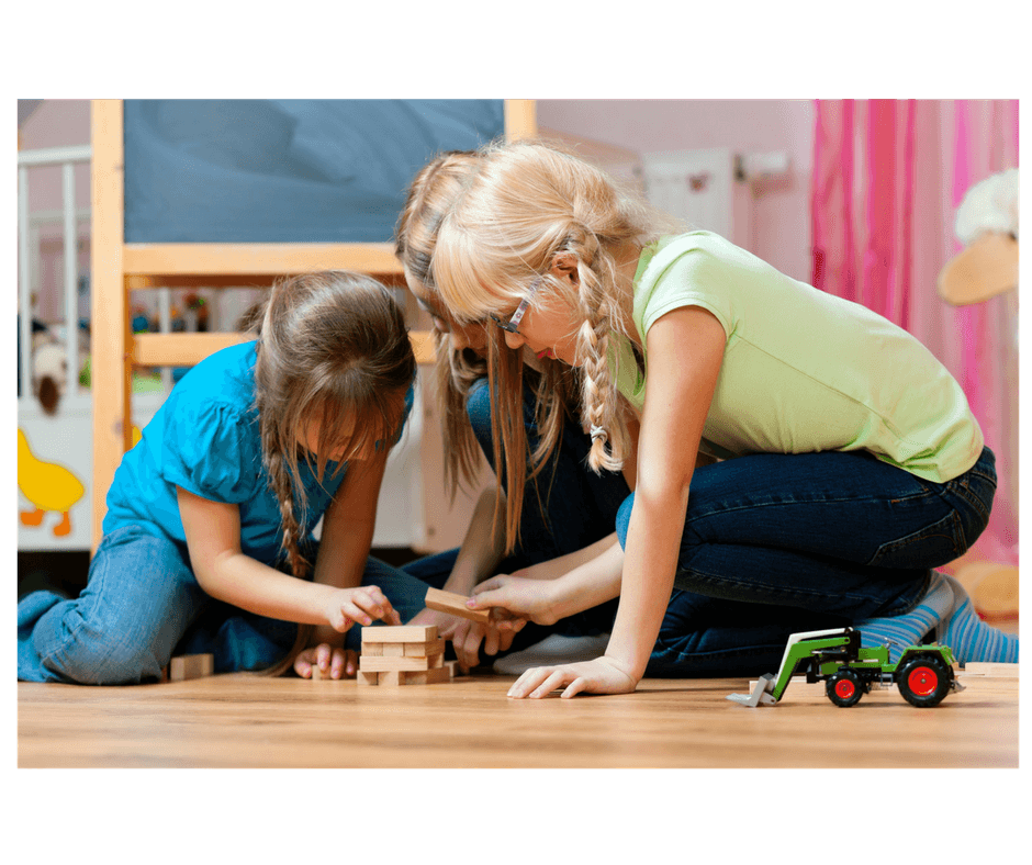 3 kids sharing builing toy