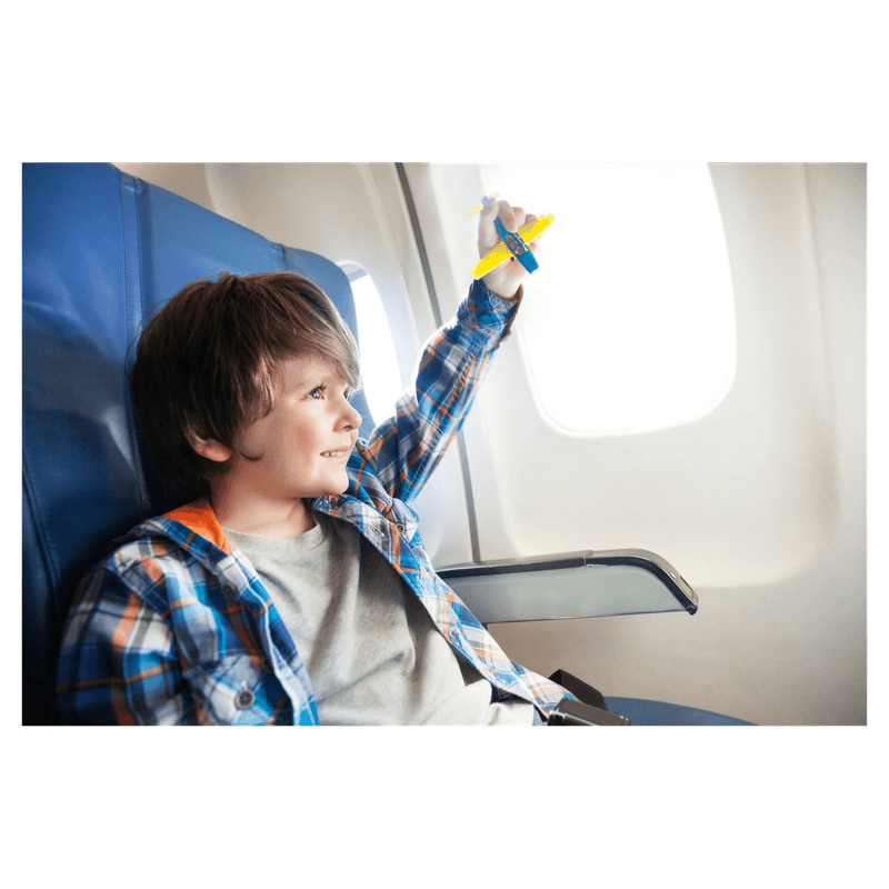 toddler boy sitting and playing on the airplane