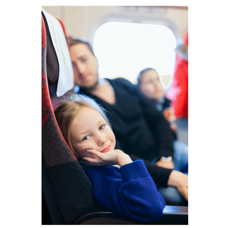 family sittign on airplane toddler girl, mom and dad
