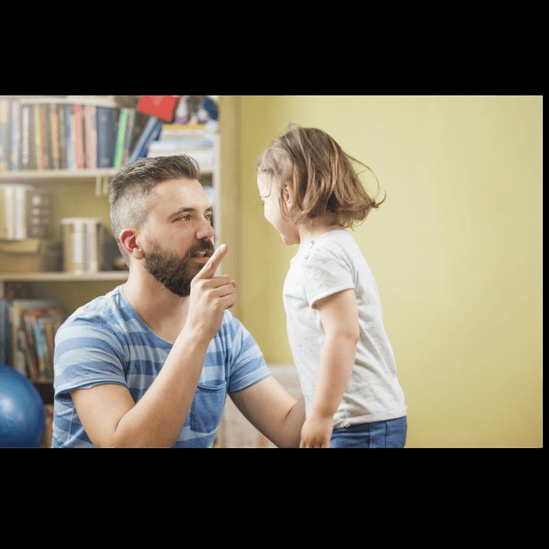 father disciplining toddler daughter