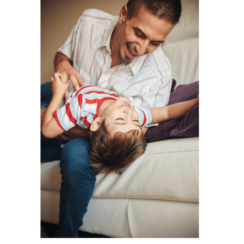 father and son playing and laughing, tickles