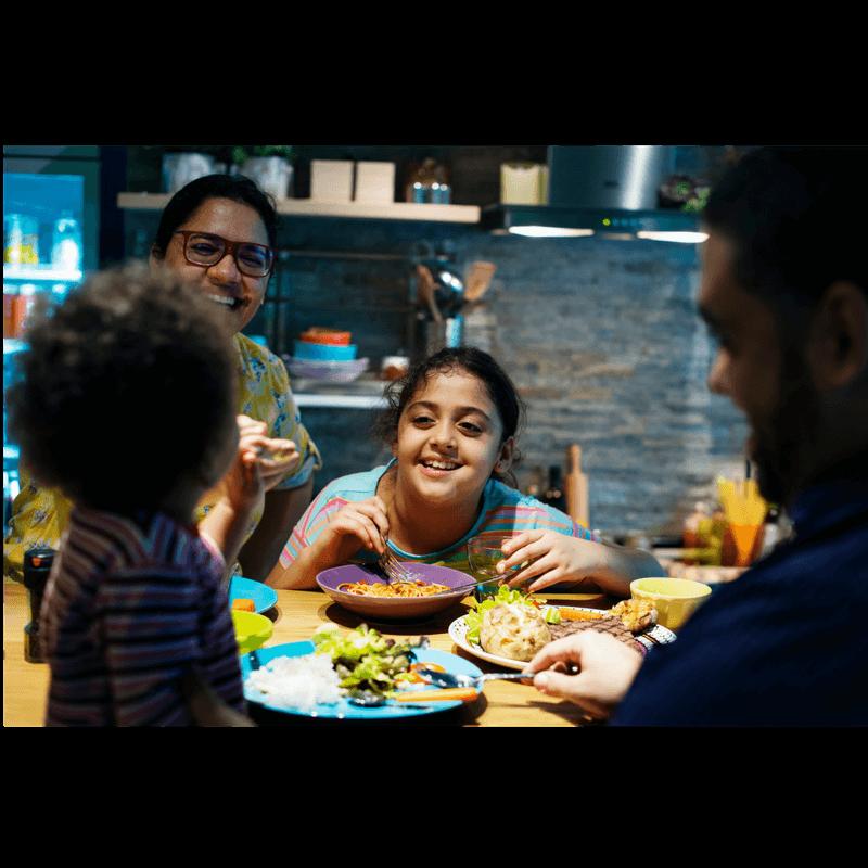 family having dinner together modeling good behavior at table