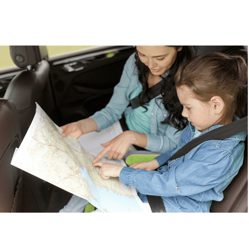 mom and daughter in the looking at a map qhile waiting to get to their destination