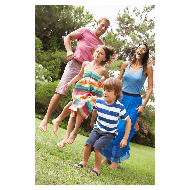 family jumping in the park