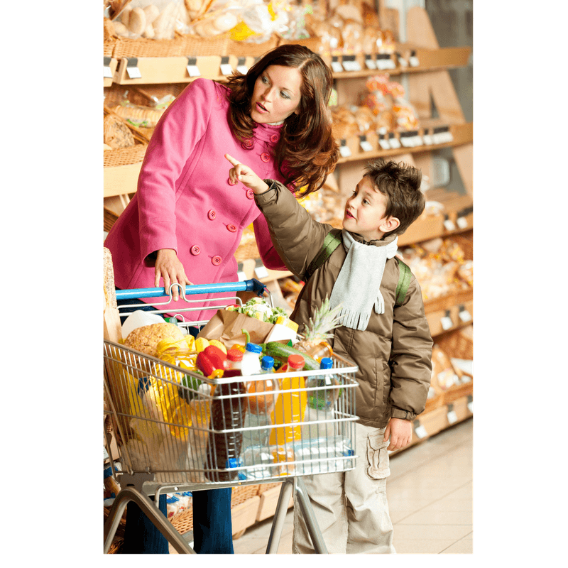 mother and son at grocery store pointing to shelves
