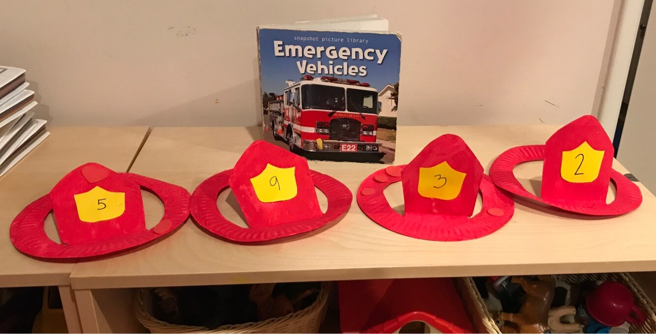 firefighter's hats made by toddlers at Early Childhood Development Associates' Class
