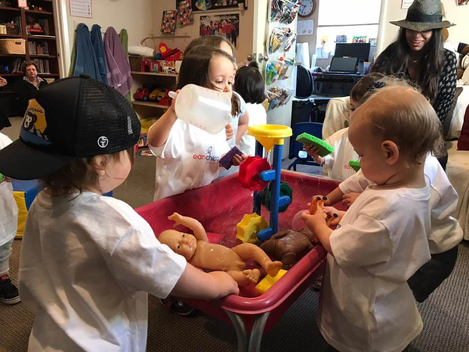 3 children playing with water at sensory table at Early Childhood Development Associates' class