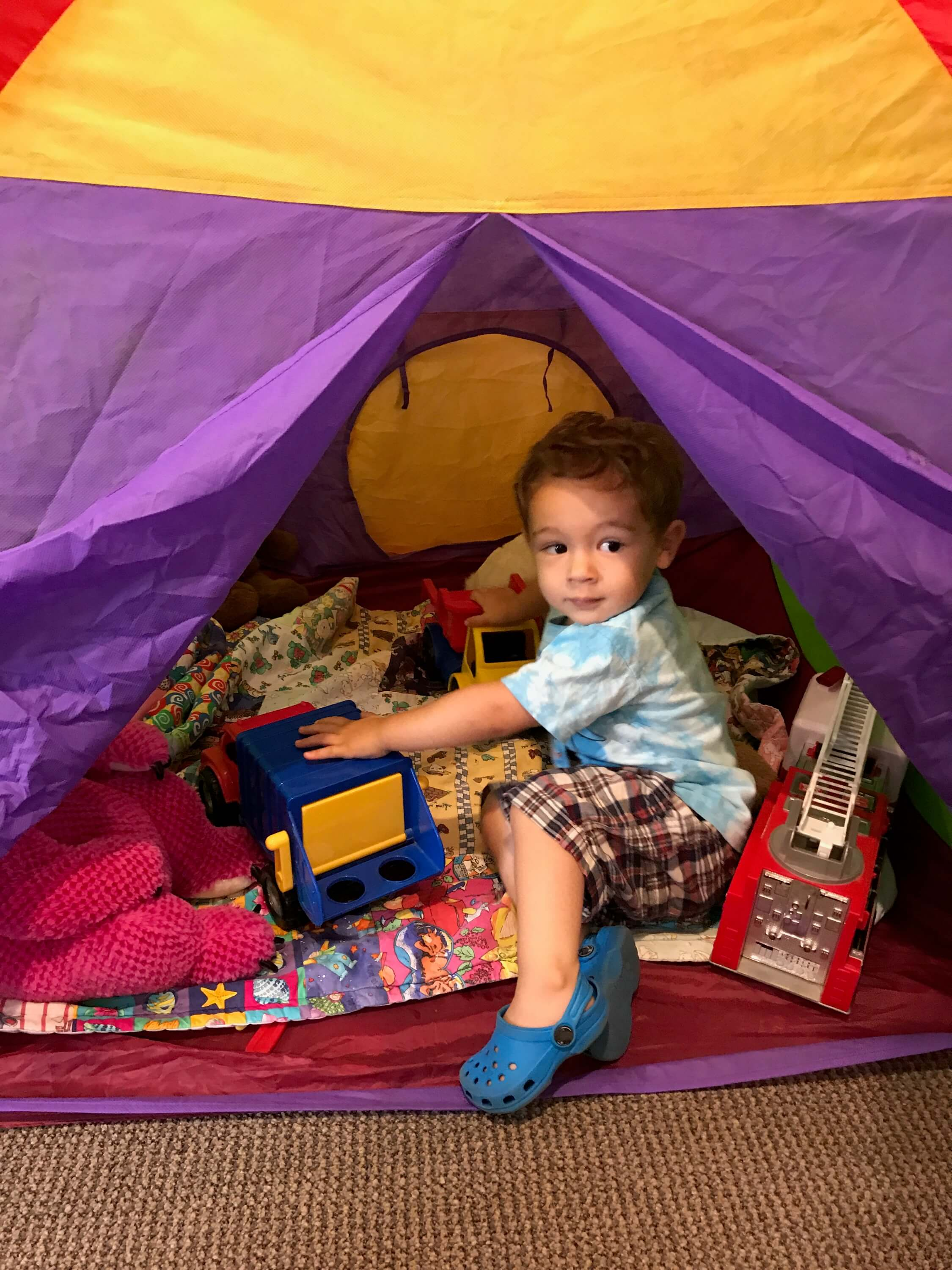 toddler playing in the tent at Early Childhood Development Associates Class