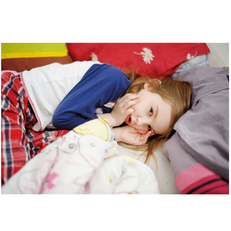 little girl lying in bed, doesn't want to leave