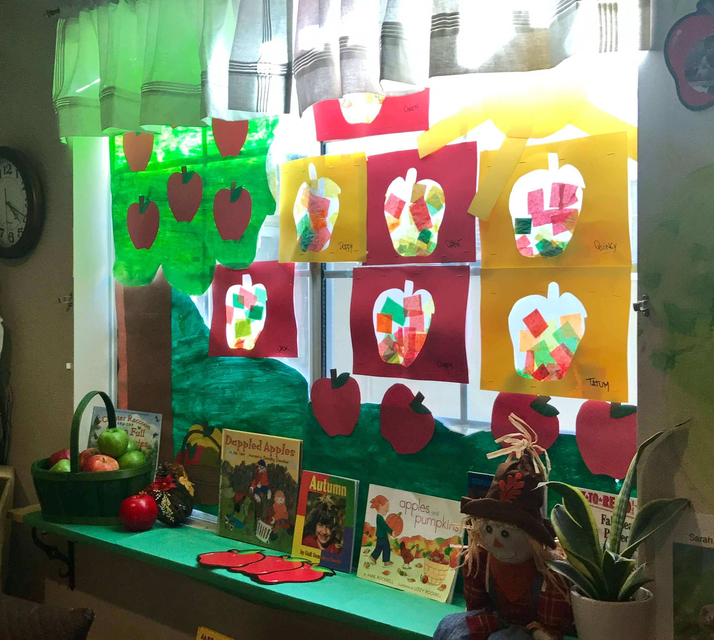 ecda's window with art projects made from the kids