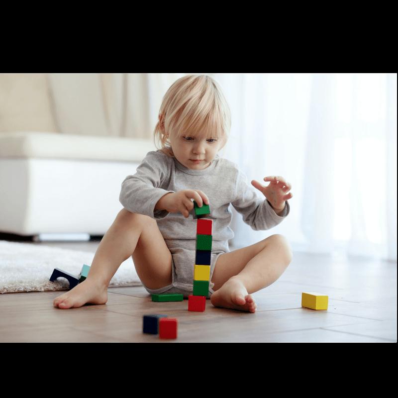 toddler stacking woden blocks